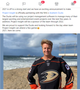 Steve West at the beach in a Ducks sweater